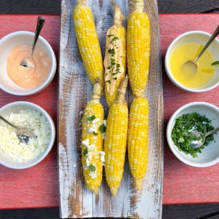 🌽 CORN ON THE COB BAR! 🌽 For this weekend's #fathersday celebration 🎉 how about a 🌽 on the cob bar? No doubt you'll have plenty of 🍔 (regular and 🌱 ) on the grill already, and corn is just about the best accompaniment.  We 💛 corn in our household, but since we eat it all summer, it's nice to make it a little special 🤩 especially for a Dad's Day celebration. You can grill or boil your 🌽 then set up your toppings. Here's what to do: 🌽Mix 1/2 cup mayo (🌱 or regular) with 1 T sriracha to make 🌶 Mayo  🌽Melt 1 stick unsalted 🧈 with juice of  1/2 a lime for lime butter 🌽Chop fresh herbs 🌿 I like cilantro and chives, but you can use whatever you like 🌽Crumbled feta or Mexican cotija 🧀 are 😋 Place in serving bowls alongside your platter of 🌽 Serve with plenty of napkins!  What's your fave 🌽 on the cob topping?  #eatmoreveggies  #fruitsandveggies  #fathersdaybbq  #fathersdayideas  #summerfood  #cornonthecob🌽  #cotijacheese  #limebutter  #spicymayo  #grillingallsummer  #summercelebrations  #dadsday  #grillingideas  #funentertaining  #easyentertaining  #goeswithburgers  #nostressfood  #thefeedfeedvegan